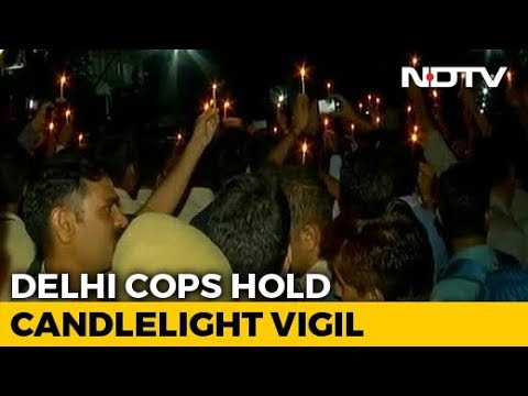 Cops Hold Candles, Joined By Families As Protest Rolls Into Night