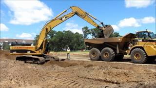 Cat 345CL Excavator Loading 740 Haul Trucks