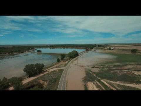 Arkansas River overflows its banks floods hwy 194