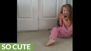 3-year-old plays adorably fun game with her kitten thumbnail