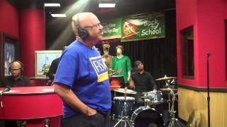 Charlie Wilson performs while visiting the Red Velvet Cake Studio