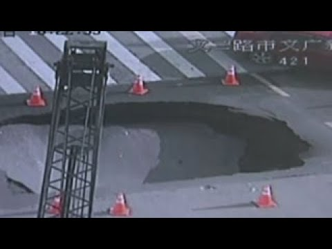 HUGE SINKHOLE OPENS UP ON BUSY INTERSECTION IN CHINA INCREDIBLE CCTV FOOTAGE