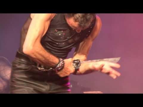 Magician cuts through arm with knife thumbnail