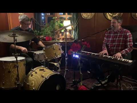 In the Air Tonight- Phil Collins-Virtuoso Cover by Danny Cottrell and Conal Duffy.