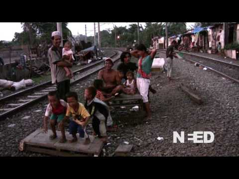 Daily life in a shantytown by train tracks  Jakarta, Indonesia