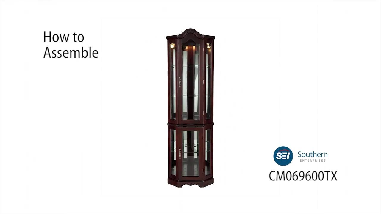 CM0696: Lighted Corner Curio Cabinet   Mahogany Assembly Video