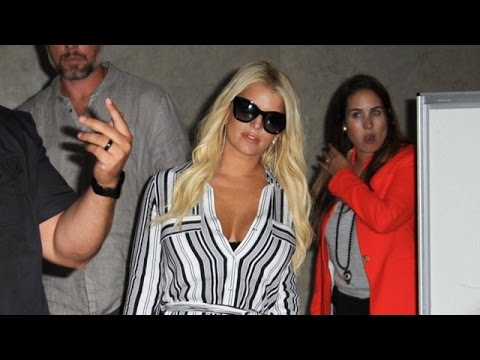 Jessica Simpson And Eric Johnson Swarmed By Photographers At LAX
