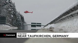 Helicopter propellers used to remove snow on trees in Bavaria