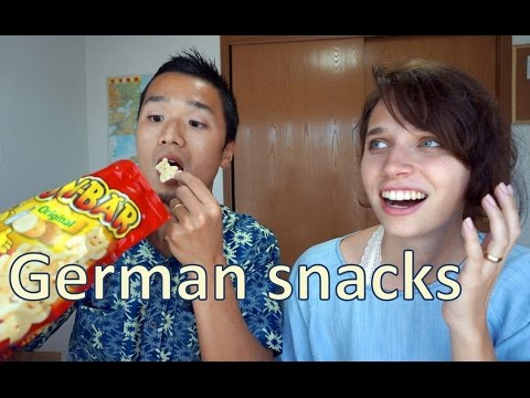 Japanese boy and American girl try German Snacks