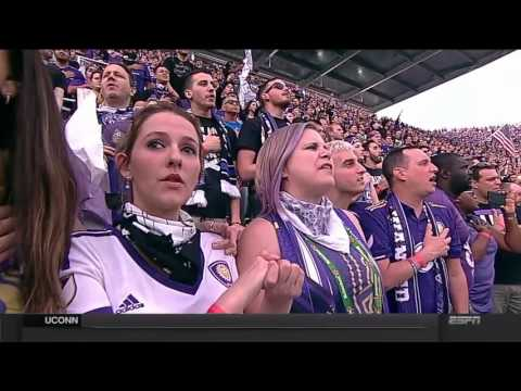 Orlando City SC fans sing the National Anthem ahead of Stadium opener