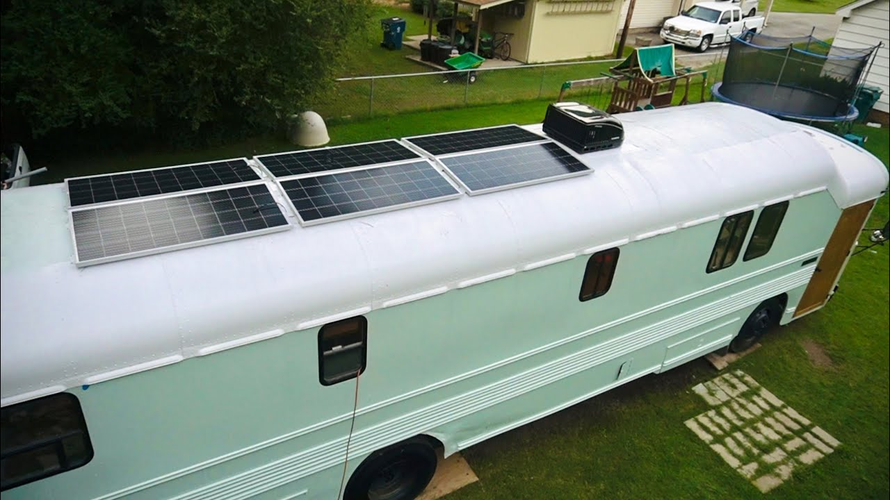 School Bus Conversion Episode 17 - Starting the solar power installation, water tank, and plumbing