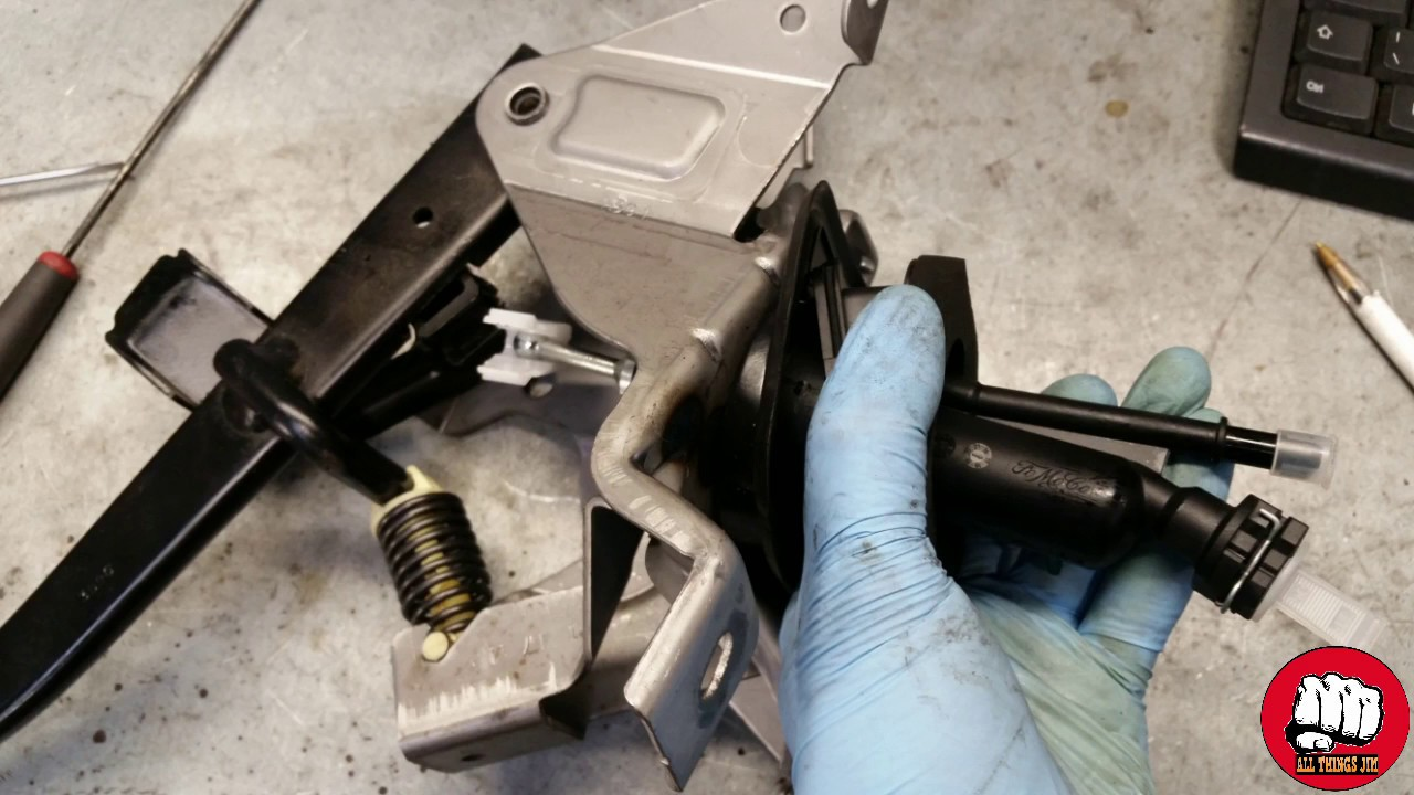 HOW TO REPLACE A CLUTCH PEDAL MASTER CYLINDER ON A FORD