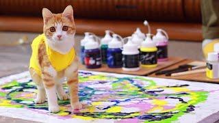 Cómo enseñar a tus gatos a pintar una obra maestra.