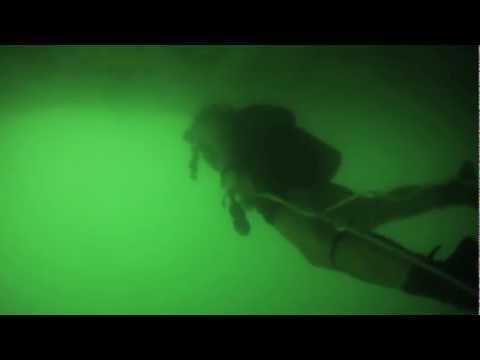Underwater Footage of Navy Divers in Bahrain Inspecting Hull of Vessel