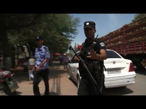 Riots in China's Xinjiang region kill dozens