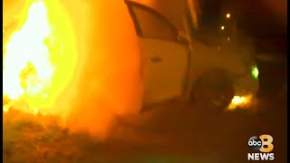VIDEO: Hero officers rescue unconscious woman from burning car