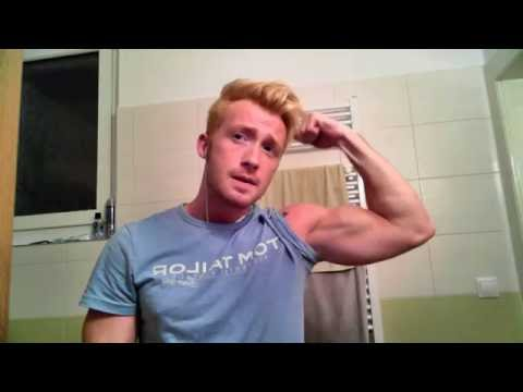 Young bodybuilder flexing his huge biceps and abs