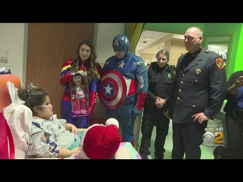police-and-superheroes-bring-hospitalized-children-holiday-cheer