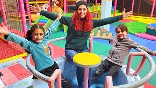 Kids have a playdate with mom at the indoor playground
