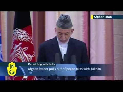 Afghanistan President Hamid Karzai announces plans to boycott US talks with the Taliban