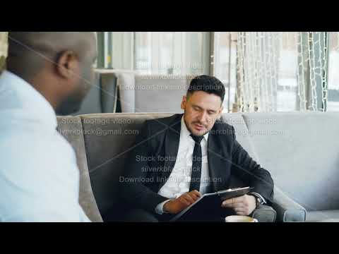 Happy Caucasian businessman laughing, gesticulating and discussing his startup project with business