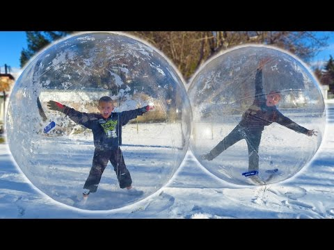 KIDS STUCK INSIDE GIANT SNOW GLOBE BUBBLE BALLS!