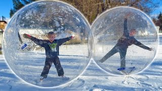 KIDS STUCK INSIDE GIANT SNOW GLOBE BUBBLE BALLS!