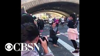 Man proposes to girlfriend as she runs the NYC Marathon