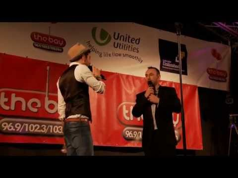 Matt Cardle introduces Paul Akister onto The Bay Radio Stage at Lancaster Christmas Lights 2014