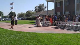 Bride Walking down the aisle at Ceremony Celebrated at The Crestmore Manor in Riverside, CA.