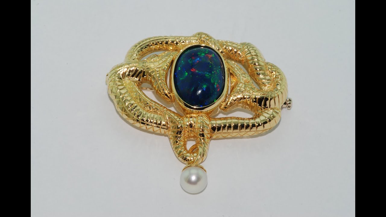 pin and a vintage black antique opal brooch demantoid enamel garnet