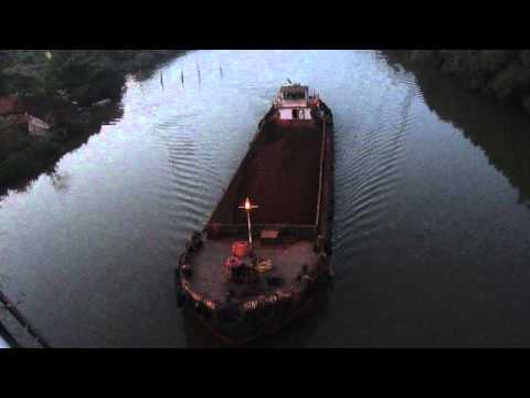 Barge carrying iron ore from Shirgao mines crossing Khorjuem bridge