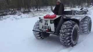 На тракторе по лужам