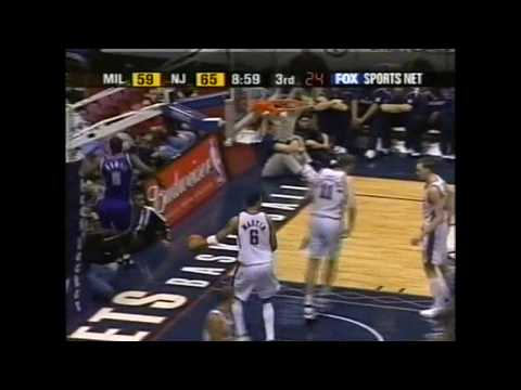 Tim Thomas` dunk over Todd MacCulloch in 2002