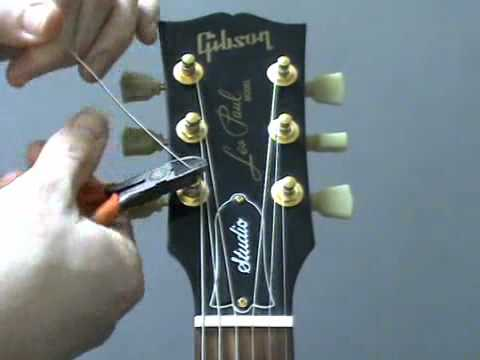 How to re string a guitar - YouTube