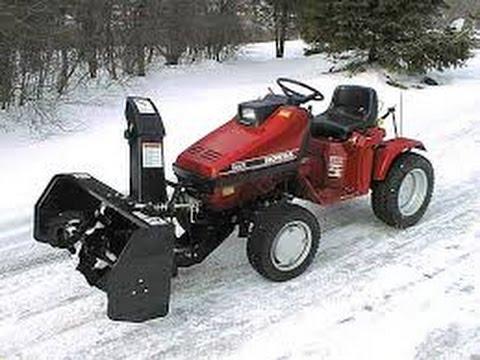 honda tractor vs newspaper - YouTube