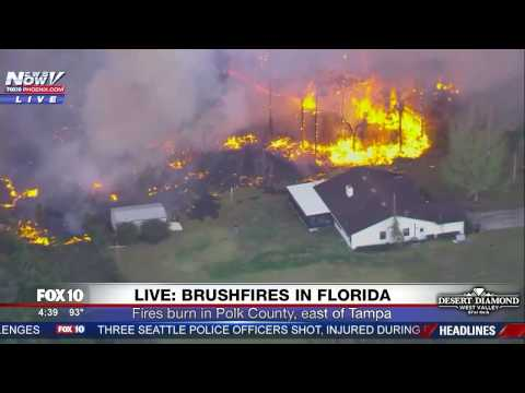 MASSIVE FLORIDA FIRES: Man Tries To Defend His Home With A Hose (FNN)