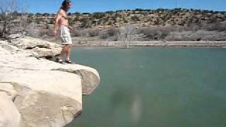 Super Dog Jumps Off Huge Rock Into Lake In Search And Rescue Training.