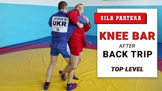 Knee bar after back trip. How to apply knee lock from standing position