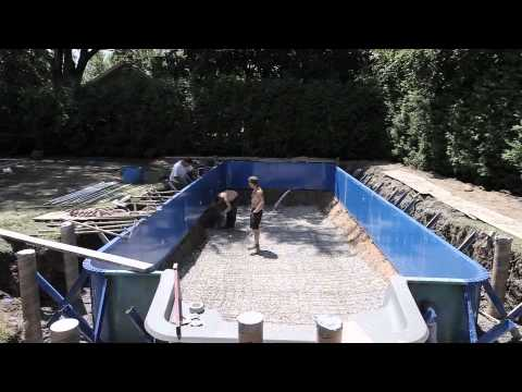 Construction d 39 une piscine hippocampe youtube for Construction piscine desjoyaux youtube