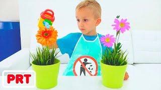 Vlad e Nikita fingem brincar com brinquedos de limpeza e ajudam mamãe