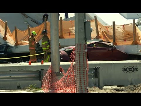 Rescue workers arrive on site after Miami bridge collapses