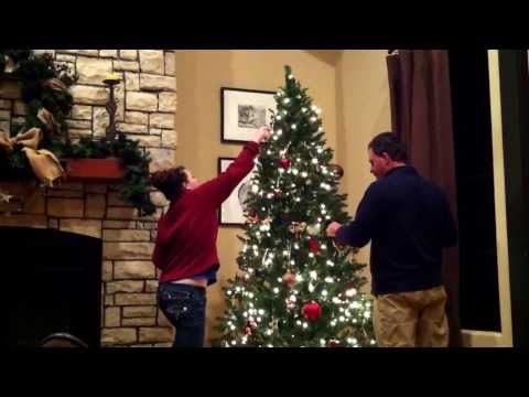 Frank and Meredith decorating the tree. 2011