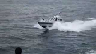 US Navy Patrol Boat Playing in the Ferry Wake