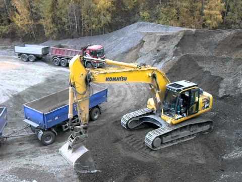 Komatsu PC 290 LC Excavator Loading A Truck W/ Trailer