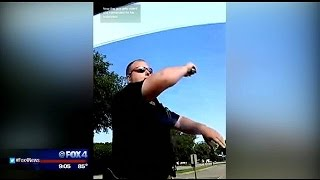 Officer smashes window after driver repeatedly refuses to comply
