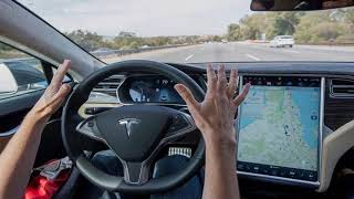 Latest Automobile News - Video shows Tesla driver asleep in moving car; Tesla calls it a prank