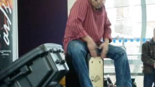Trilok Gurtu plays cajon.