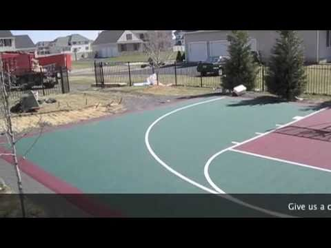 Installing a versacourt tile court doovi for Build your own basketball court