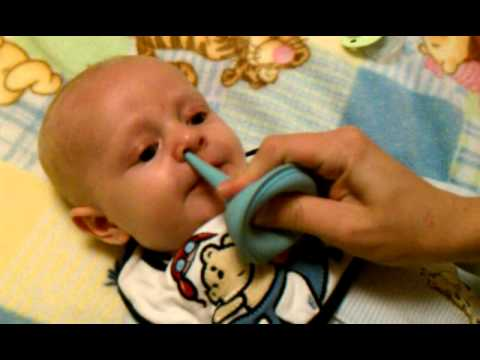 How to suck snot out of a baby's nose with a bulb syringe ...